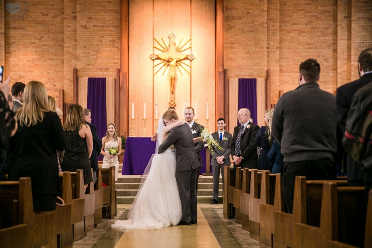 wedding photographs at Church of the Resurrection in Lansing Michigan , bride's entrance