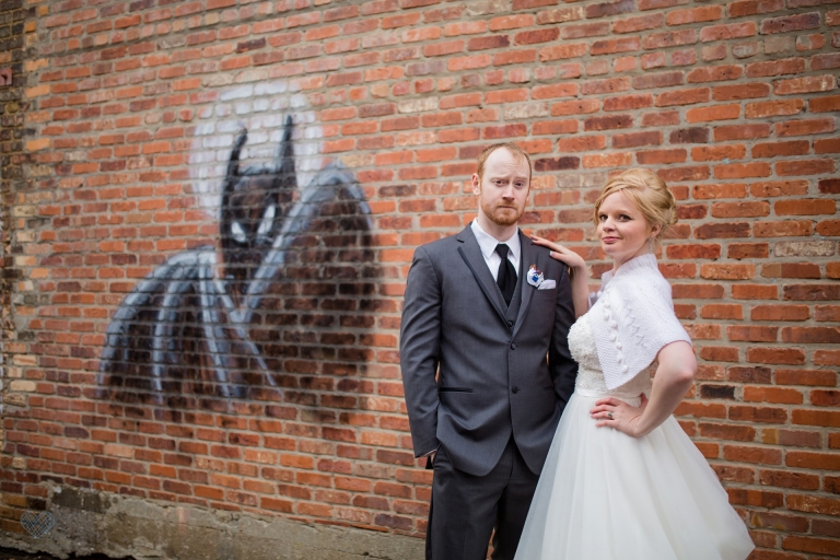 wedding photographs near Batman graffitti in Old Town Lansing
