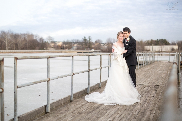 Winter wedding photographs on a dock in Plymouth, Michigan