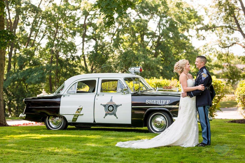 antique police cruiser wedding photographs