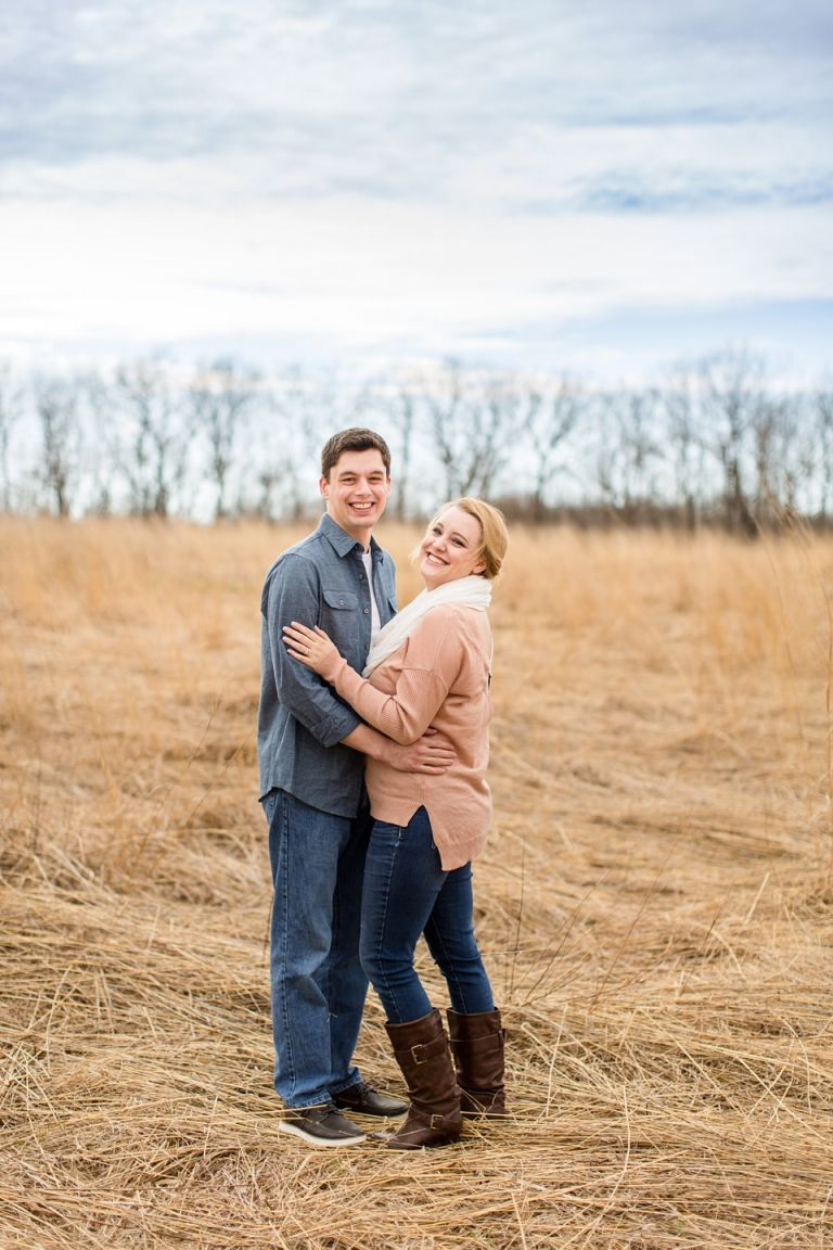Spring engagement photographs in field Michigan