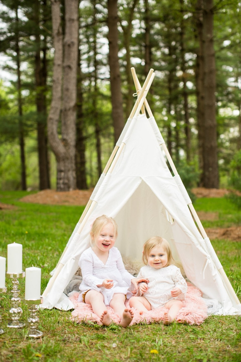 Teepee photo session with toddler sisters