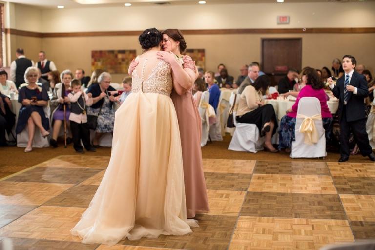 Okemos Conference Center wedding reception photographs on the dancefloor