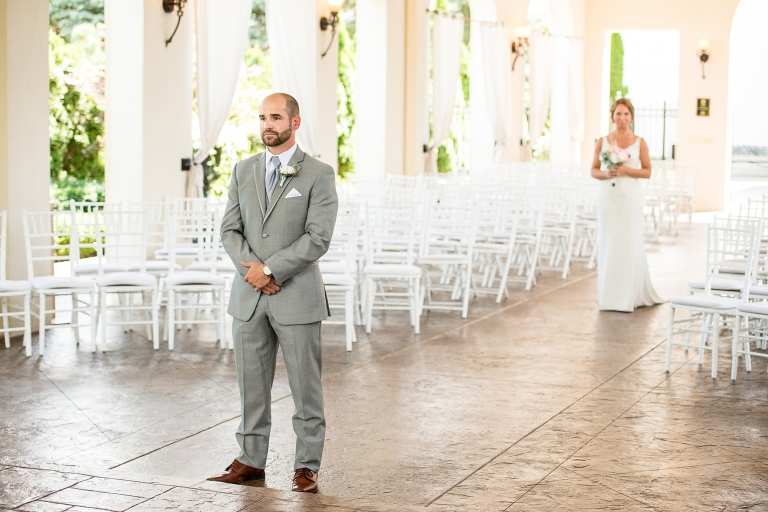 First look between bride and groom at the Crystal Gardens Event Center in Howell, Michgan
