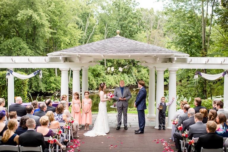 Wedding photographs under the pergola at the English Inn, Eaton Rapids