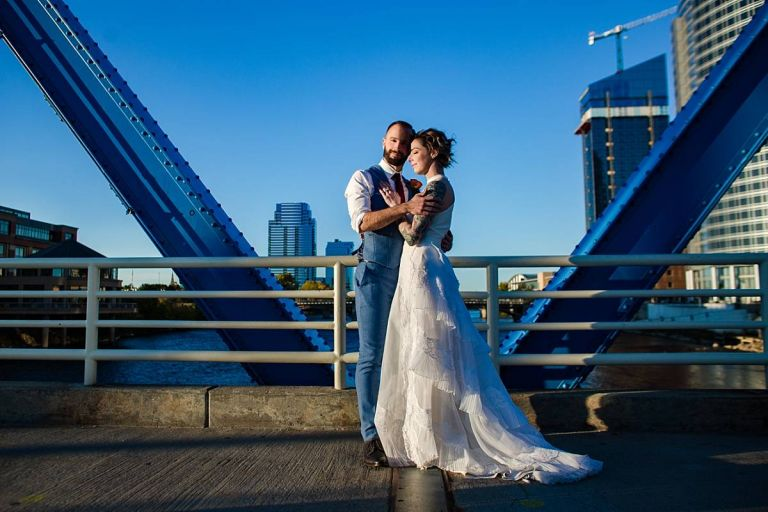 Wedding photographs at sunset on the Blue Bridge in Grand Rapids Michigan